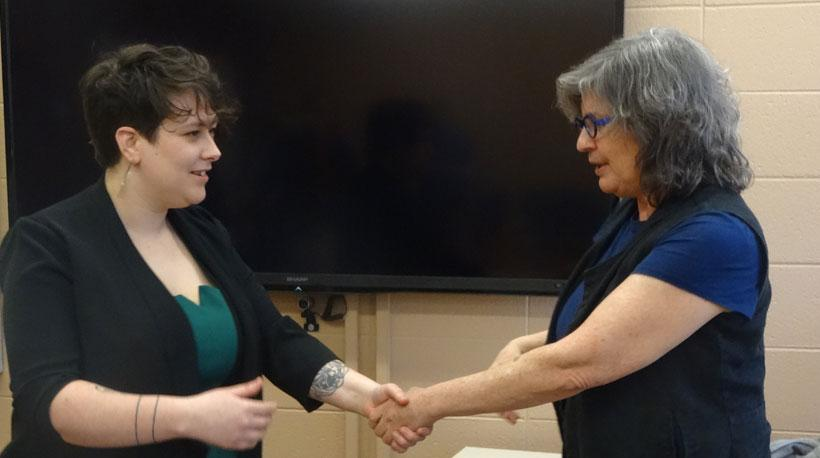 Ashley Mog and Dr. Sherrie Tucker shaking hands